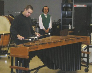 "Tomek Arnold (1st-year international percussion student from Poland) performs movement 1 of ""TORSE III"" by Miyoshi, as Professor Kazunori Meguro of the Showa Academy observes."