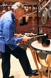 Bill resonating the temple bells on a kettledrum