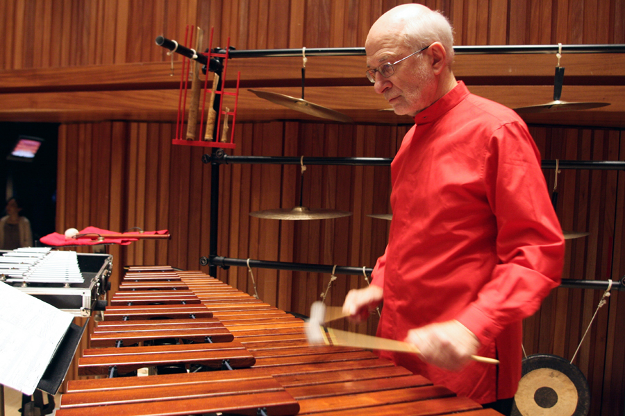 Russell plays the marimba from upstage right