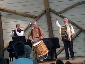 "Therese Cuccia on fife, Bill on long drum and Garry Kvistad on bass drum in a performance of ""A Day in George Washington's Camp"" at a young people's concert in Woodstock, NY on Aug. 7, 2010"