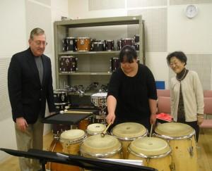 "(l.-r.) Bill, Mai Miazawa (freshman), and Ms. Iishi (translator) discussing ""Side-by Side"" by Michio Kitazume"