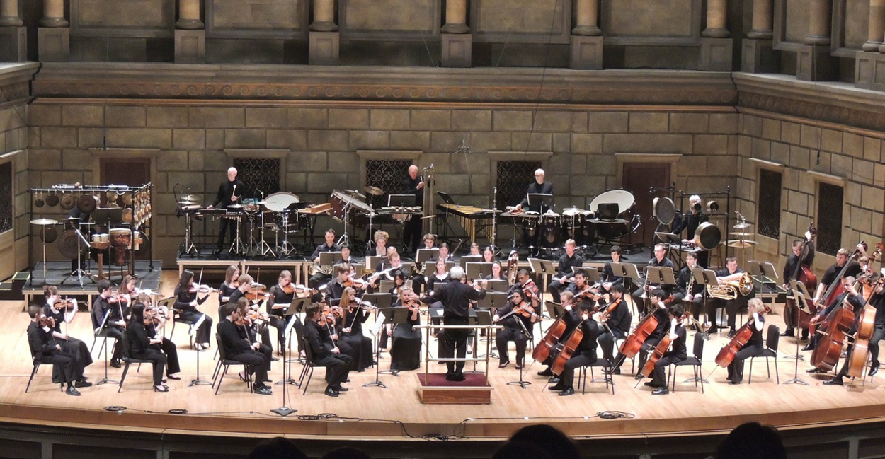 NEXUS with the Eastman Philharmonia, conducted by Neil Varon in the Eastman Theatre on May 5, 2012. (left to right in the back - Bill Cahn, Bob Becker, John Beck, Russell Hartenberger, Garry Kvistad)