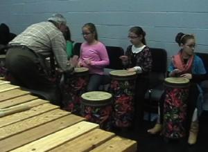 "Demonstrating a simple rhythmic pattern in ""Damba"""