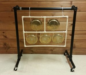 Photo 17 - A PVC frame/rack for small gongs suspended in an Ultimate Support rack having casters